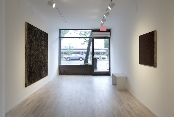 installation view (from left to right): Graphite Painting on Gold and Graphite Monochrome