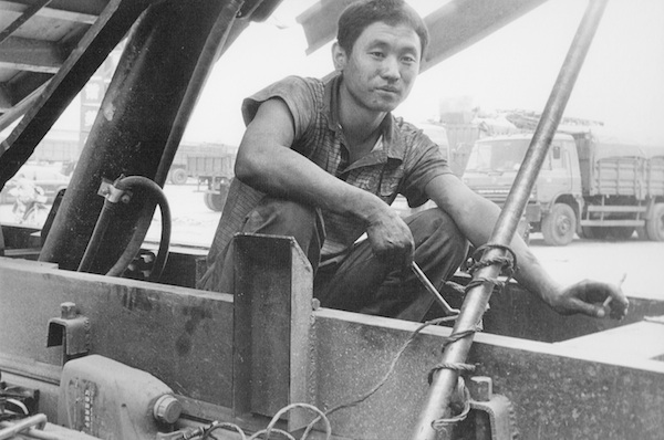 Huairen, Mechanic in Truck, 2009 gelatin silver print 8 x 10 inches